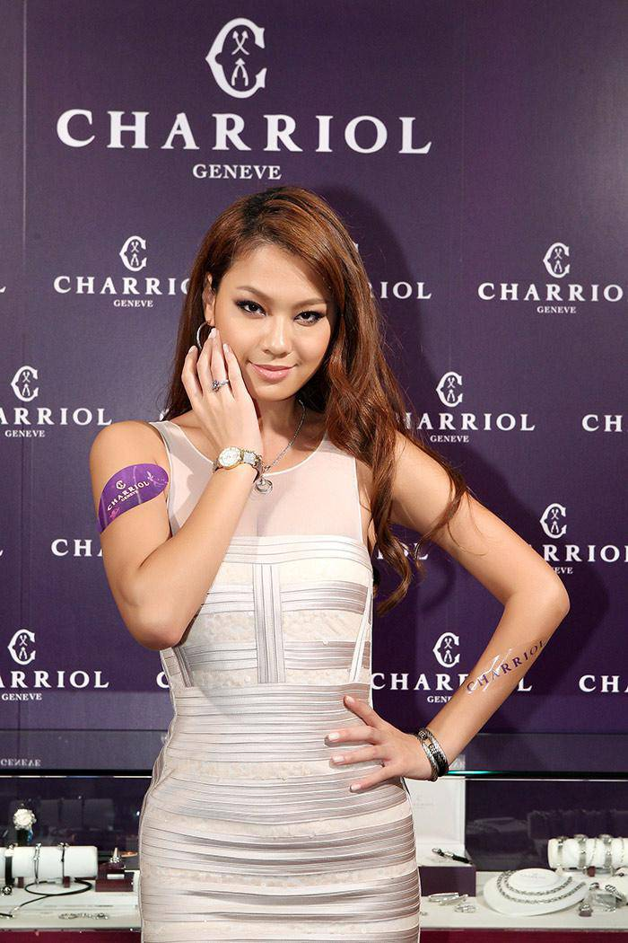 Wang Li-Ya with Charriol St-Tropez diamond watch