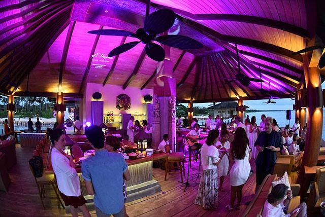 Charriol-Guests-enjoying-themselves-at-the-sunset-viewing-hut-in-Bali-Village-Balesin-Island