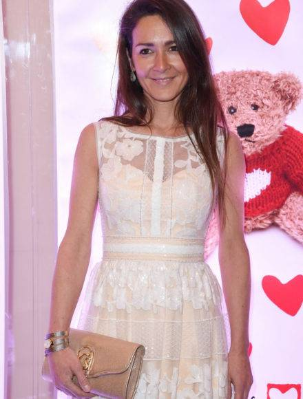 Emmanuelle-Boidron-in-a-Christophe-Guillarmé-dress,-Charriol-earrings-and-watch