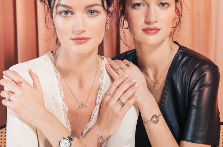 2 ladies are wearing the TOUCH and LOVE jewelery collection