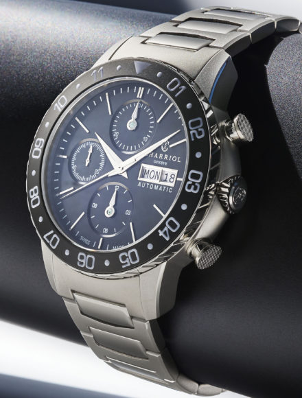 Watch Alexandre C automatic chrono seen from the side. It is attached to a black leather base.
