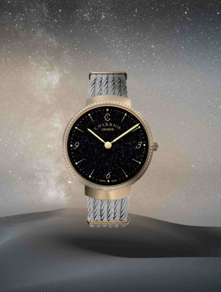 SLIM Aventurine with gold bezel under a rain of stars. Watch is wearing the steel cable bracelet : the emblematic Charriol touch.
